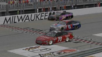 Corey Davis (#70) crosses the finish line just ahead of Matt Delk (#6) and Tim Johnston (#54).