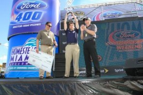 Ray Alfalla celebrates his NASCAR PEAK Antifreeze  Series championship on stage at Homestead/Miami
