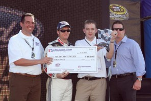 NASCAR star Dale Earnhardt, Jr presenting the $10,000 check to Richard Towler