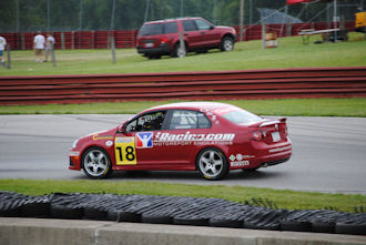 Wyatt on track at Mid-Ohio in his iRacing.com sponsored VW TDI Cup car.