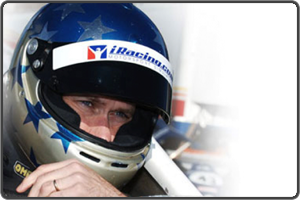 Dave Kaemmer buckles into a Skip Barber Race Car
