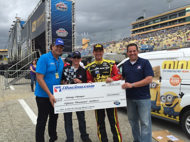 Michael Waltrip, Clint Bowyer and Steve Myers present Kenny Humpe (second from left) with NASCAR PEAK Antifreeze Series winnings.