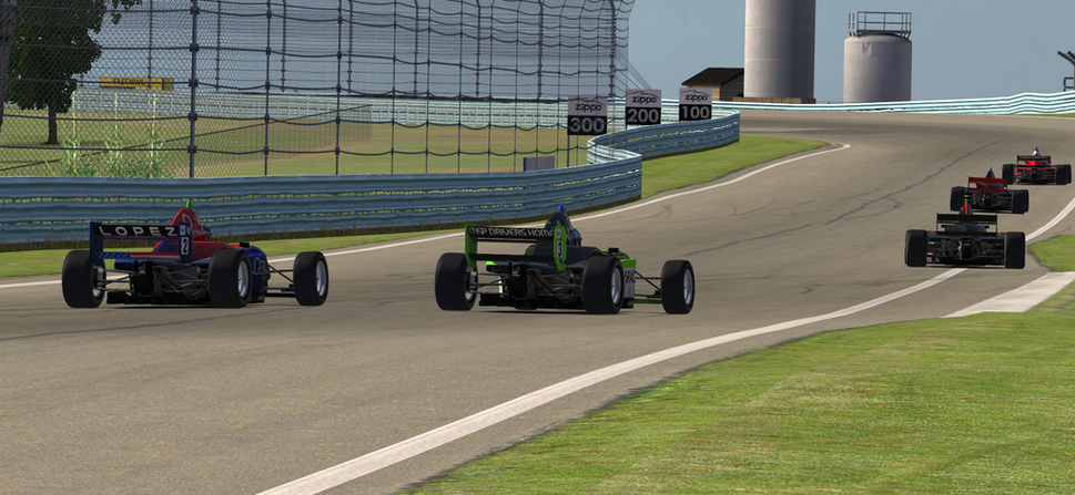 Lopez (2) waited until the final lap to make a successful move on Tanson (3) for fourth.
