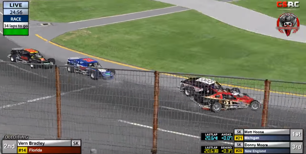 Vern Bradley (#14) makes heavy contact with race leader Matt Hoose (#21) heading into turn 1.