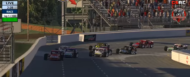 Matt Hoose (#21) leads Donny Moore (#26) to the start/finish line to complete lap 1.