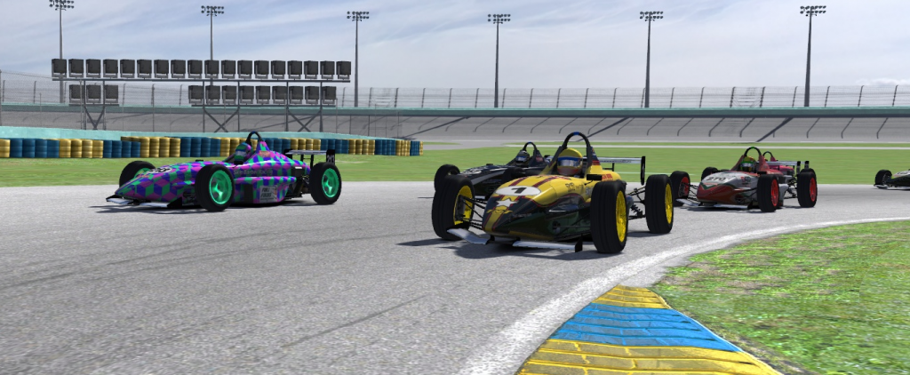 Phillip Leybaert passes Mikko Nassi, while Ricardo Faria and Vinicius Rocha battle behind.