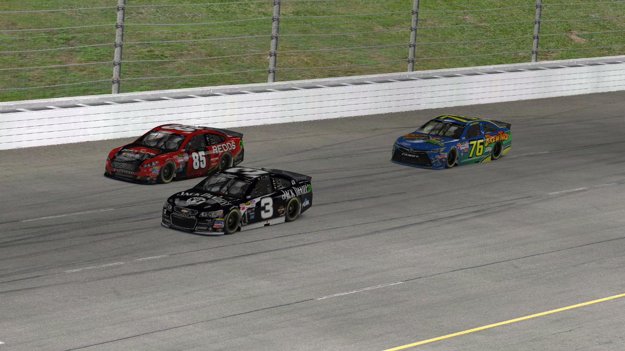 Jeff S. Davis (#3) and Matt Murphy (#85) race side-by-side for fifth place on Lap 89 while Rick Thompson (#76) watches on.