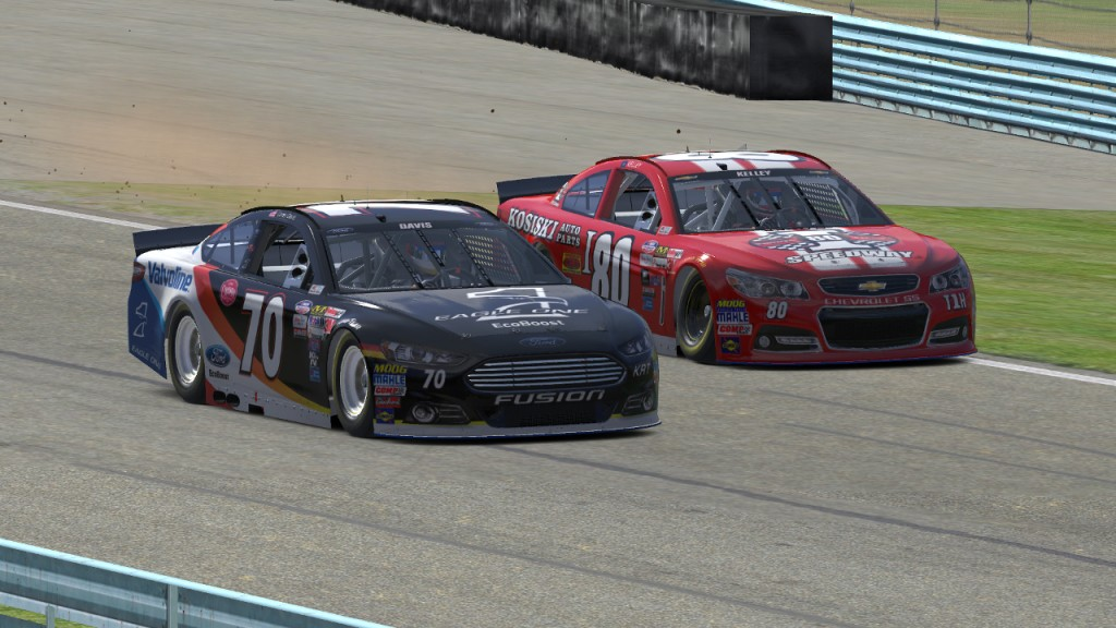 Corey Davis (#70) passes Mike Kelley (#80) for the race lead on Lap 26.