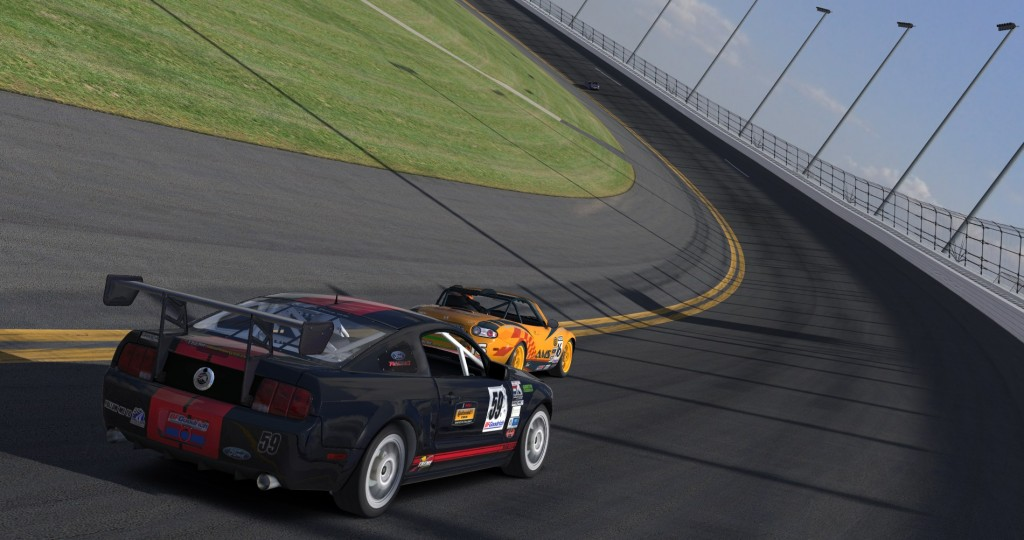 Scott Brooks (#59) moves his Mustang to the high line to pass ST driver Travis Schwenke (#16) on the banking of Daytona.