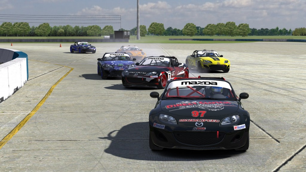 In the final corner of the opening lap at Sebring, John Allen (#22) inadvertently tapped the bumper of Drees Nice (#7) sending his Mazda into a spin that would also collect Robert Hartley (#12) and Travis Schwenke (#16), while top qualifier Brad Wootton (#97) sped away to an insurmountable lead and the race win.