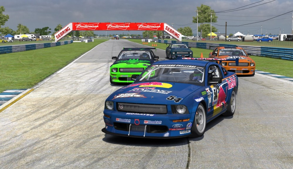 Travis Davis (#54) dives into the hairpin turn at Sebring just ahead of challengers Russell Rudduck (#95), Bob Herra (#33) and Raymond Bader (#526) in a great battle for fourth through seventh place mid-race.