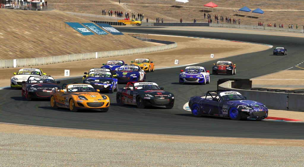 The ST Class Top Qualifier, John Allen (#22) leads the field of Mazdas on the opening lap at Laguna Seca.
