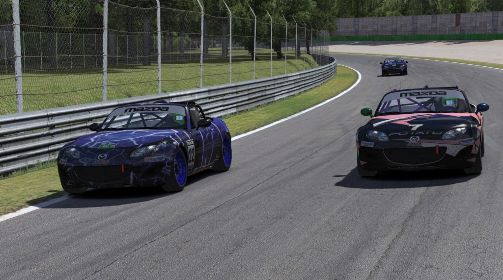In what would be the final pass for the lead in the ST class, Nicolas Taeymans (#7) overtakes John Allen (#22) in turn one on Lap 34.