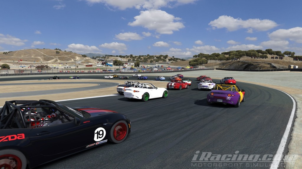 More than two dozen MX5s negotiate the Andretti Hairpin on the opening lap.