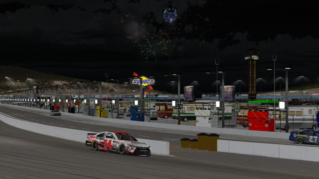 Tim Johnston takes a victory lap while the fireworks shoot off in the Phoenix sky.