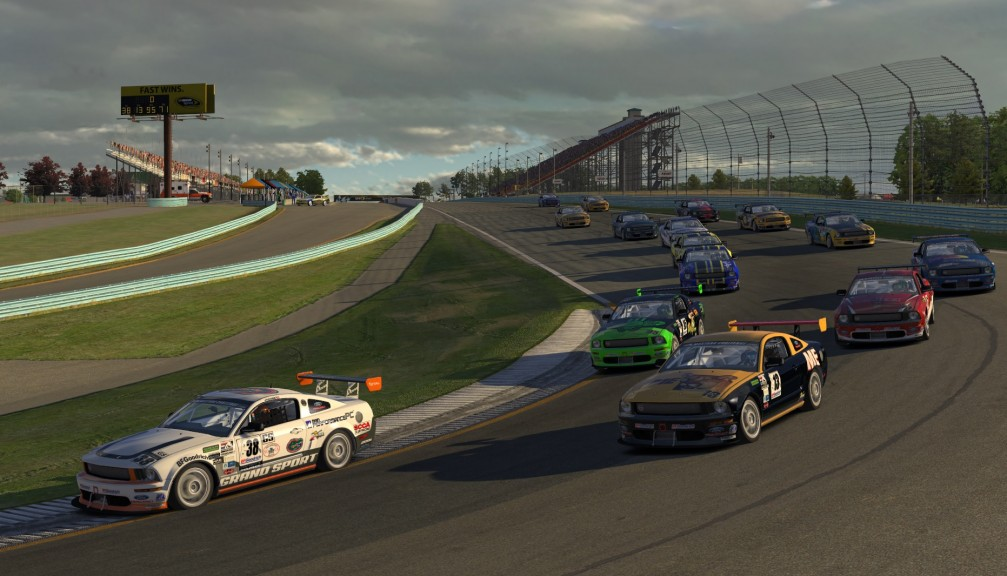 The GS class of 15 Mustangs pours into Turn 1 on the opening lap at Watkins Glen.