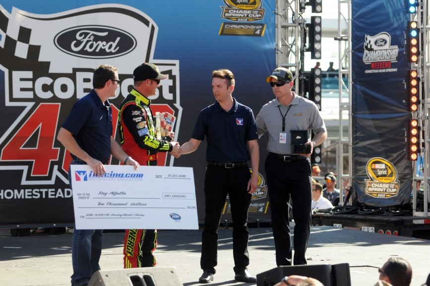 Alfalla recieves his championship check, trophy and ring from NASCAR Sprint Cup series driver Clint Boyer